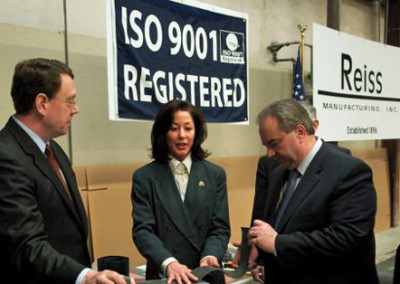 Susan Brooks describes the product to Lt. Governor and C. Reiss.